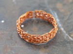 Completed woven ring form in copper