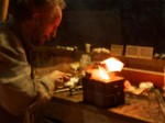 Pouring silver into casting mold