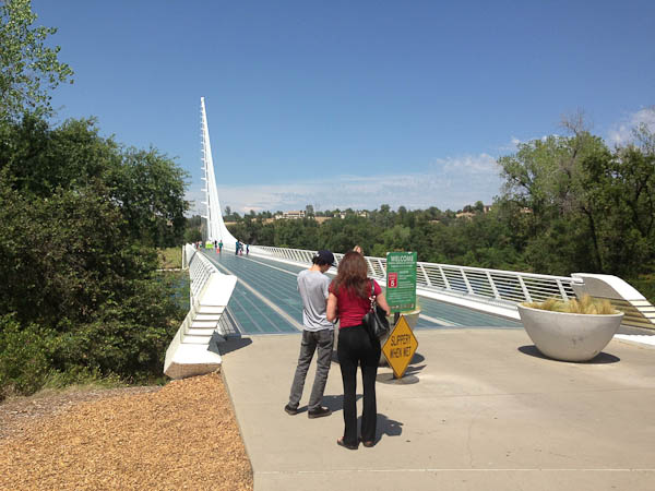 "Calatrava's Sundial Bridge in Redding, California.  ""Slippery When Wet"" sign.  Glass decks are pretty and good for the fish below... but really?"